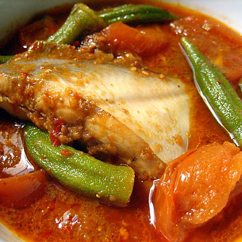 "Assam Pedas, or literally ""sour spicy,"" is a classic Malaysian dish. Everyone has their own interpretation for this favorite dish and there are endless adaptations; suffice it to say, it's sour, fiery hot, and tastes extraordinarily satisfying. 