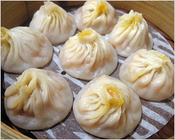 Eating Xiao Long Bao (Shanghai Soup Dumplings)