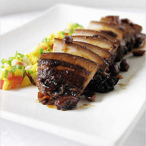 Humba is an interesting dish. This slow braised pork belly is coated in a sweet glaze of panocha or palm sugar and given depth of flavor with the addition of soy sauce, salted black beans, and star anise. | rasamalaysia.com