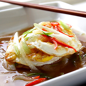 A few eggs drenched in the ever-appetizing sweet and sour sauce served with steamed white rice plus dollops of sambal belacan (a Malay style sambal with roasted shrimp paste). | rasamalaysia.com