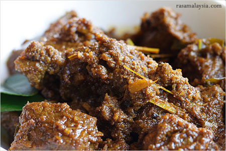 This is beef rendang it literally looks like shit but it's one of my ...