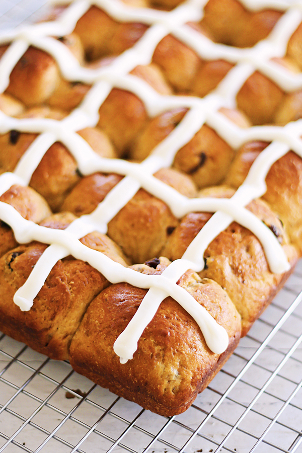 Hot Cross Buns - soft, fluff and pillowy hot cross buns spiced with cinnamon, cloves and loaded with dried fruits. So good you can't stop eating!!   rasamalaysia.com