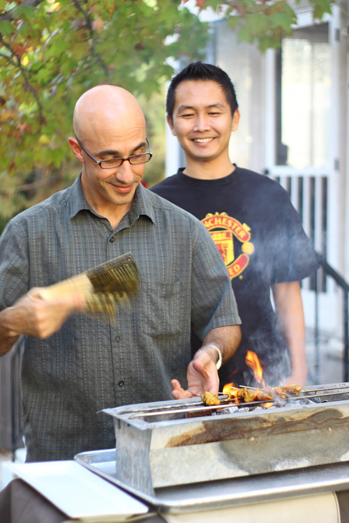 Chef Danhi grilling satay and LK lurking from behind