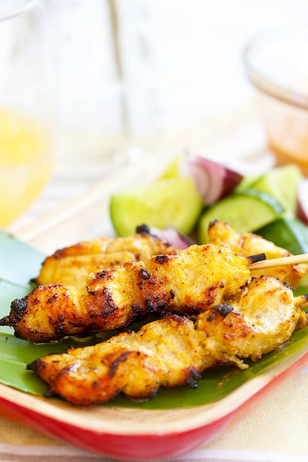 Chicken satay - grilled chicken skewers marinated with spices and served with peanut sauce. Easiest and BEST chicken satay recipe ever | rasamalaysia.com