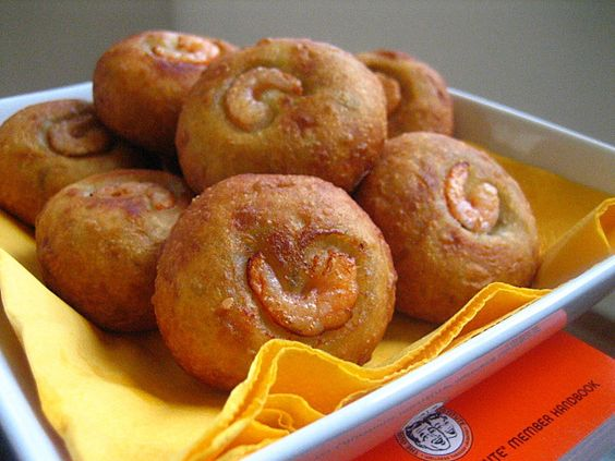 Cucur Badak recipe - Filled with grated coconut seasoned with turmeric, lemon grass, red chilies, and dried shrimps, the fillings are wrapped with sweet potatoes dough instead of glutinous rice. | rasamalaysia.com