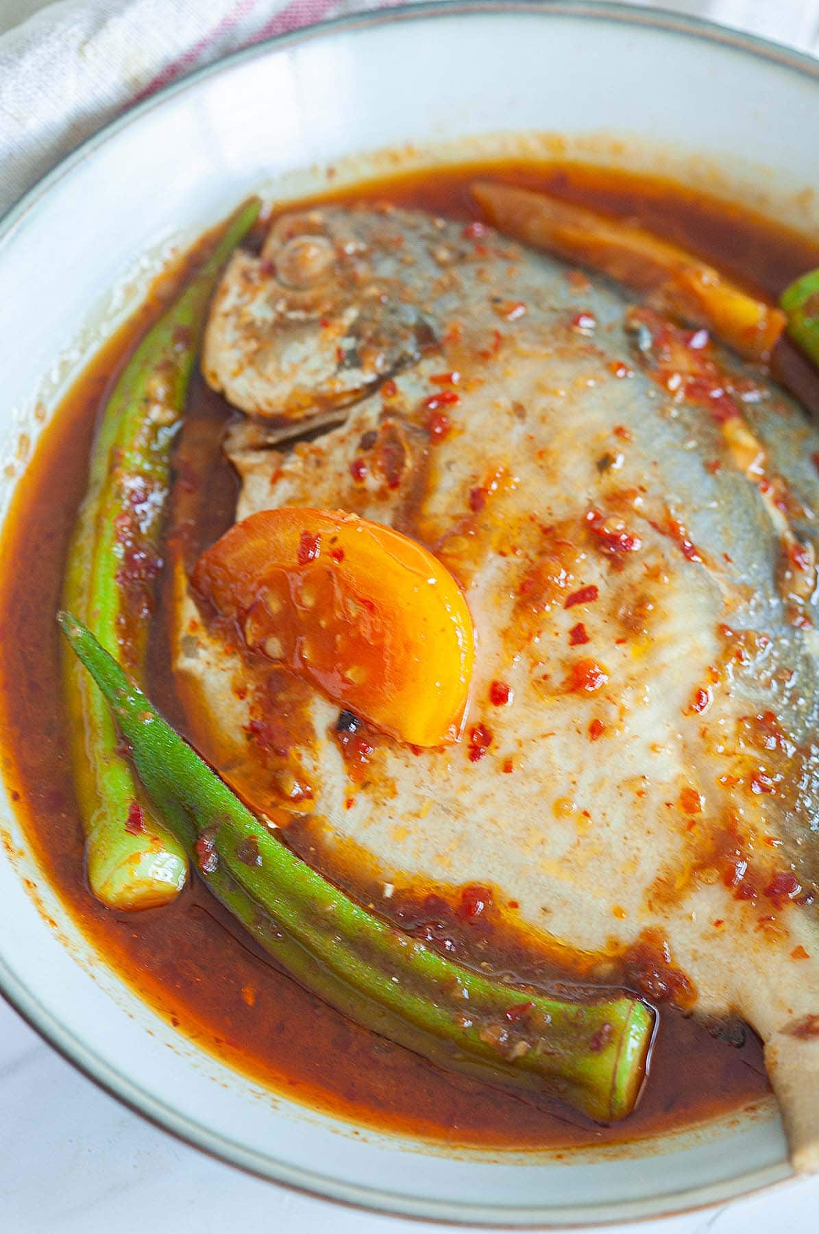 spicy sour sauce on top the fish prepare to serve.