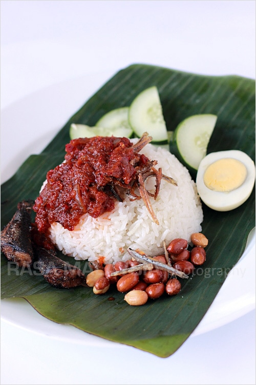 Malaysian coconut milk rice, served with sambal, fried crispy anchovies, toasted peanuts and cucumber on banana leaves.