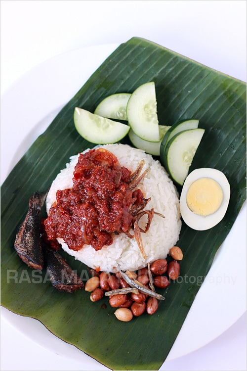 Homemade authentic Malaysian Nasi lemak served on a banana leaf.
