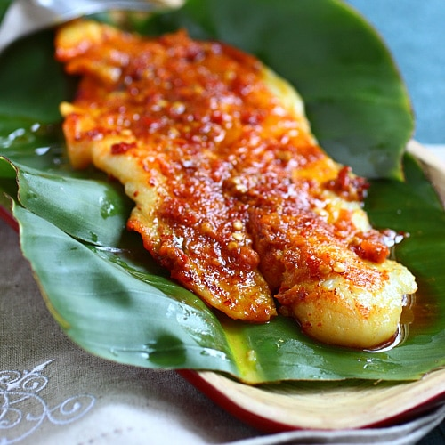 Ikan Panggang/Ikan Bakar Recipe (Grilled Fish with Banana Leaves): Loaded with dollops of sambal or spice paste, the fish is grilled with banana leaves over charcoal fire. | rasamalaysia.com