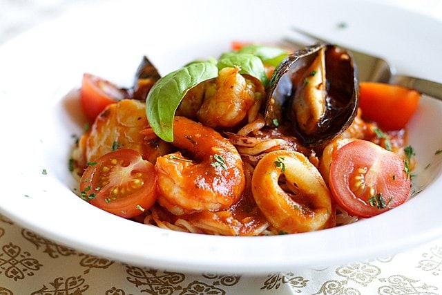 Angel Hair Pasta with Seafood Recipe - Florida rock shrimp, calamari rings, scallops, shrimp, mussels, cherry tomatoes, and freshly-plucked sweet basil leaves. | rasamalaysia.com