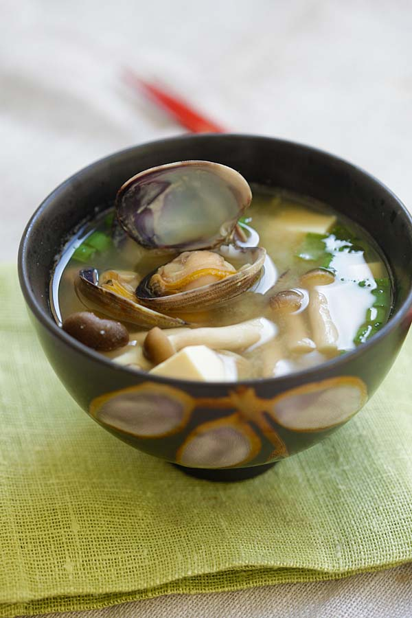Quick and easy Japanese miso soup with Manila clams in a bowl ready to serve.