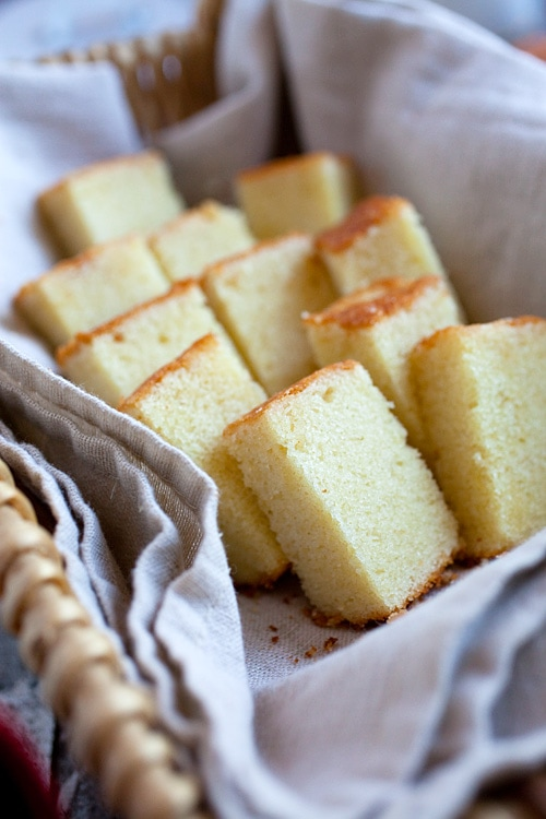 Rich, moist and fluffy butter cake, sliced into pieces.
