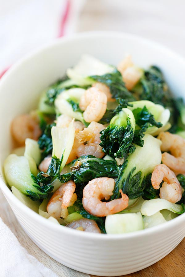 Healthy and delicious baby bok choy stir fried with shrimp in a bowl, ready to eat.