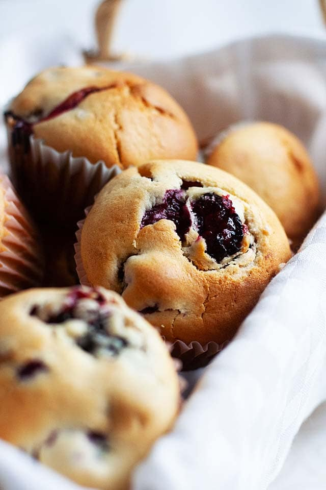 Blueberry muffins in a serving basket.