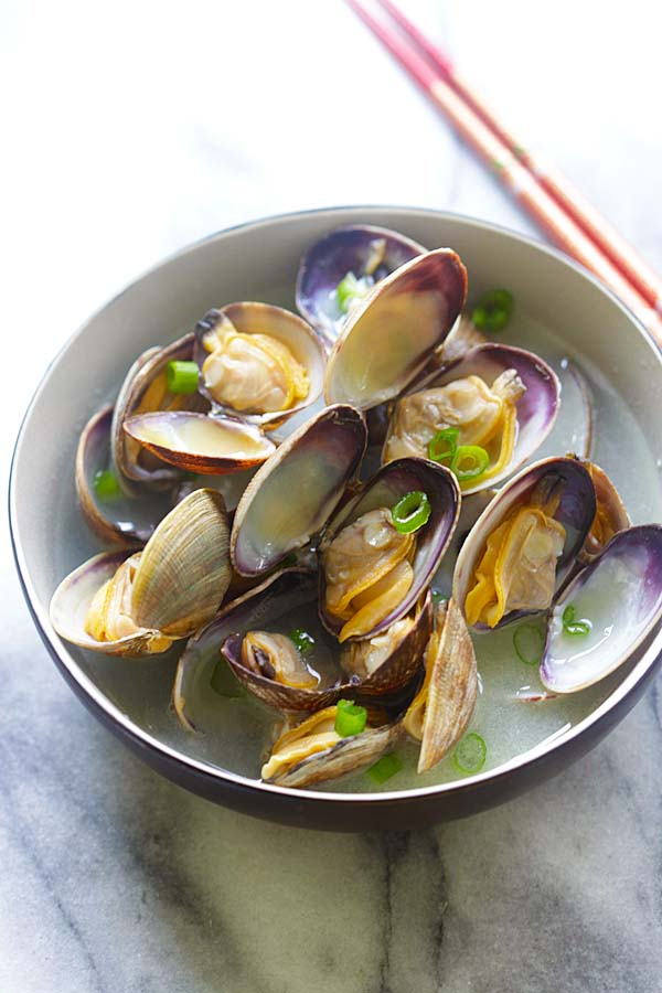 Fresh Japanese Manila (Asari) clams steamed with butter, Japanese sake and mirin in a bowl.