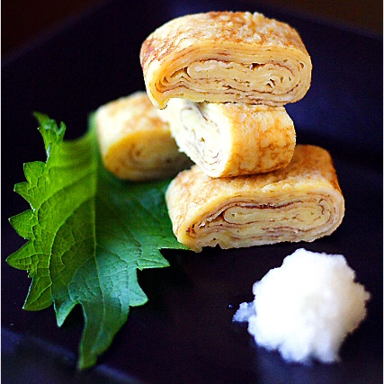 Tamagoyaki is a slightly sweet, delicious, and delicate omelet that is often packed into Japanese bento boxes and also served at sushi bars as tamago nigiri | rasamalaysia.com