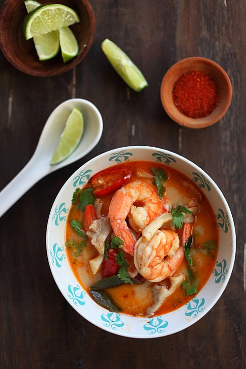 Top down view of delicious Tom Yum Soup with shrimp and mushroom, a delicious Thai recipe, laid in a bowl.