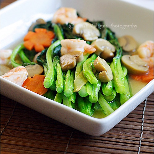 In Chinese or Cantonese restaurants, Chinese vegetables (choy sum) are often served two ways: brown sauce or white sauce--a recipe I am sharing with you today. | rasamalaysia.com