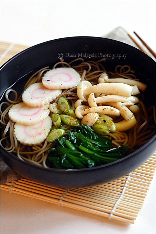 "Soba (Japanese Buckwheat Noodle) recipe - I made soba or Japanese buckwheat noodle soup, topped with my favorite Japanese fish cake ""naruto"" , boiled spinach, and some buna shimeji mushrooms. 
