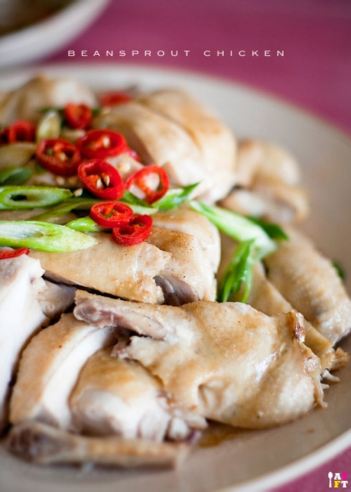 Ipoh Bean Sprout Chicken (芽菜鸡) recipe - The chicken is poached in a water bath then quickly dunk into cold water to stop the cooking process to retain its juicy smoothness texture. The bean sprouts will only need to be blanched no more than 10 seconds, then drizzle with sesame oil and soy sauce, and a smidge of white pepper for bit of kick. | rasamalaysia.com