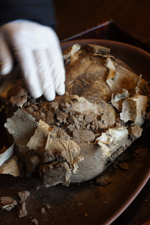 Removing the mud and revealing the parchment paper/wax paper