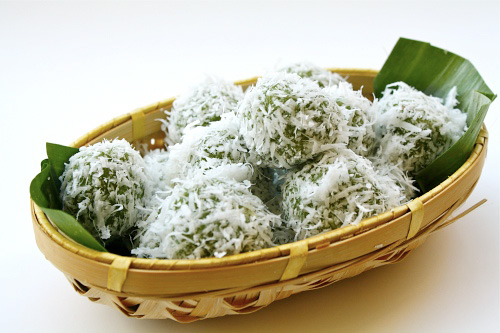 "Onde-onde (Ondeh-ondeh) recipe - These cute little pastries are infused with pandan (screwpine leaf) juice and filled with ""Gula Melaka"" or palm sugar and then rolled in with some fresh grated coconut. 