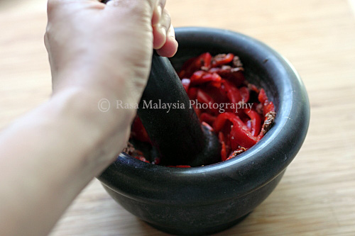 Grinding ingredients for Sambal belacan