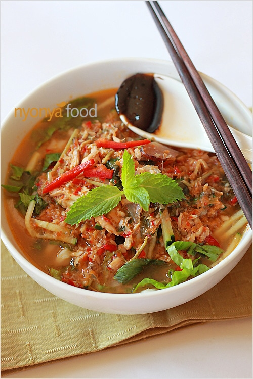 as Asam laksa, the piquant, pungent, sour, and fiery hot noodle ...