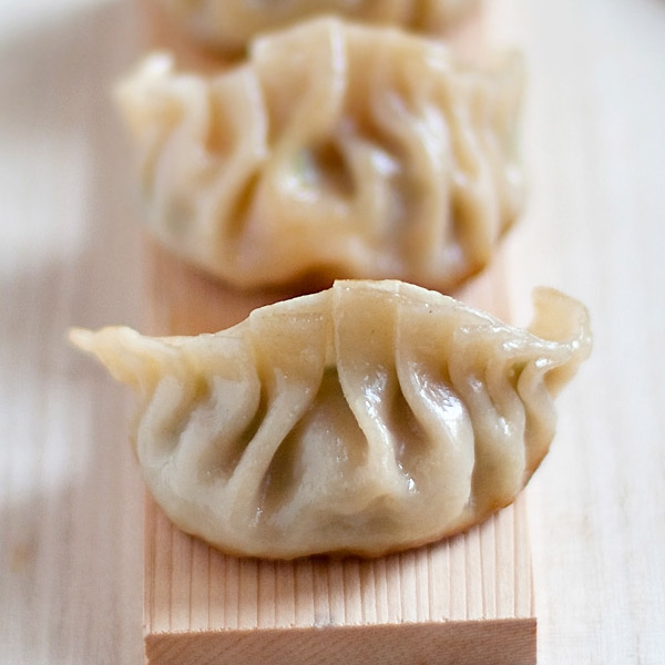 Gyoza or Japanese pan-fried dumplings are SO delicious. EASY gyoza recipe made with store-bought ingredients, cheap & a zillion times better than takeout.   rasamalaysia.com