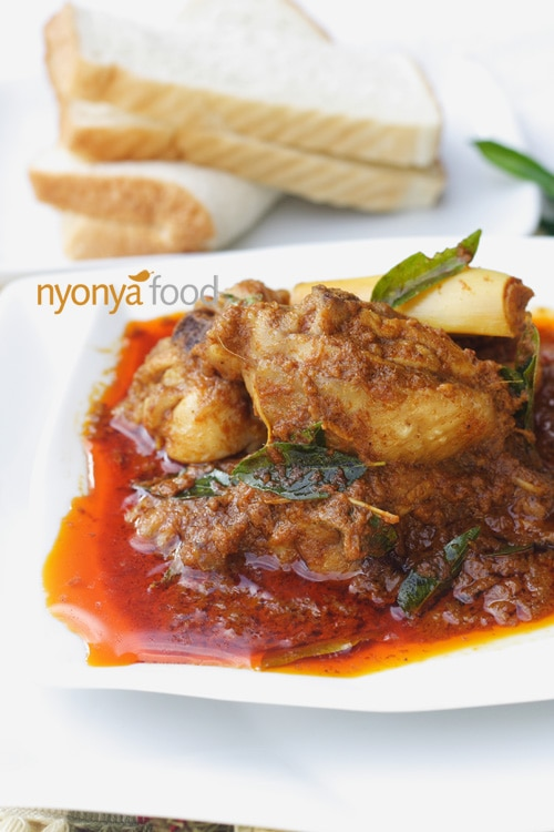 Chicken curry is made with bone-in chicken traditionally, and curry leaves are used to infuse the chicken curry with the intense fragrance of the curry leaves. | rasamalaysia.com
