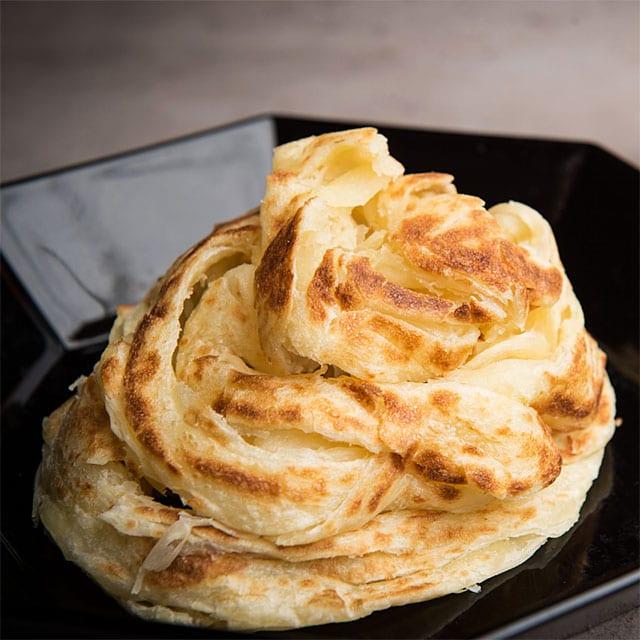 Roti canai or roti paratha (prata.