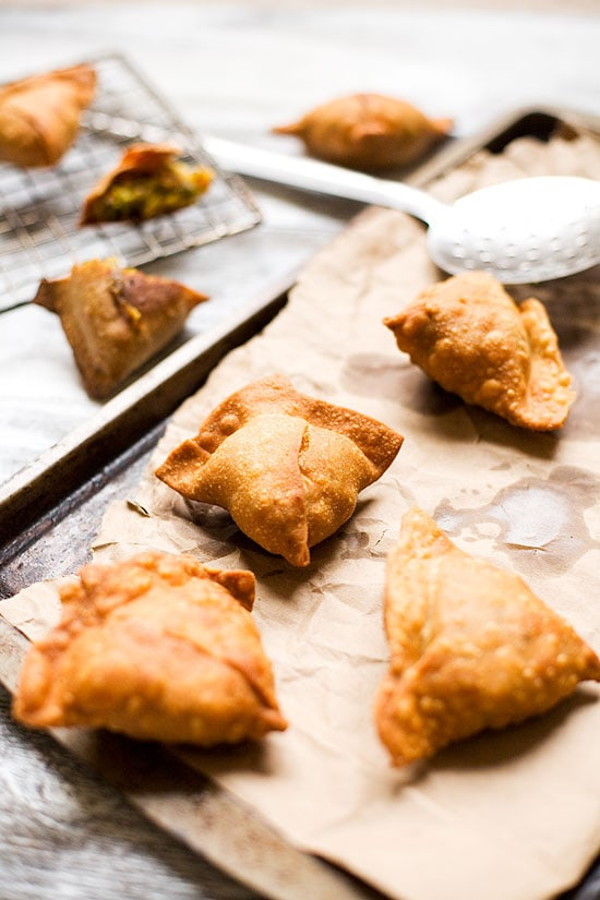 Samosa Recipe: It's a stuffed pastry which is mostly fried in oil and is triangular in shape. Any kind of filling can be used from minced meat to something sweet like sweetened coconut filling.   rasamalaysia.com