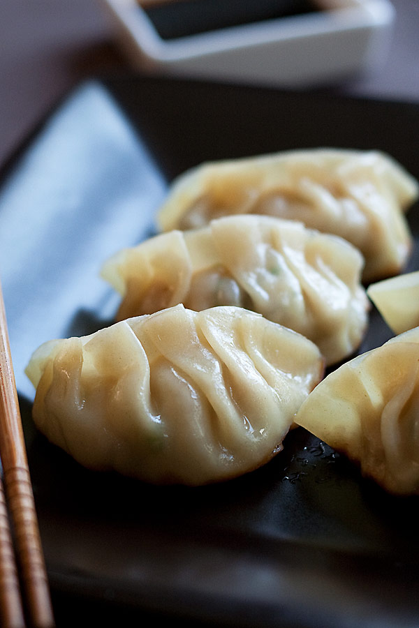 Gyoza or Japanese pan-fried dumplings. Moist on the inside and crispy and golden brown on the outside.