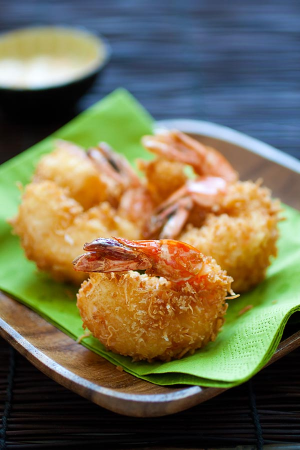 Fried coconut shrimp recipe that yields jumbo coconut shrimp, ready to serve on a plate.