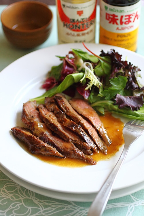Grilled flank steak on a plate.