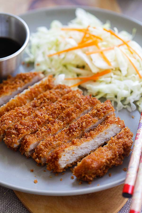 Sliced Japanese Tonkatsu cutlet in a plate ready to serve.