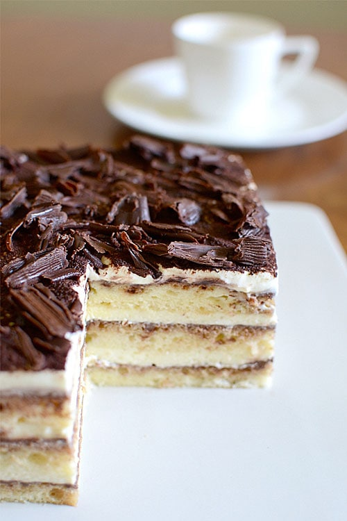 Easy and delicious eggless Japanese Tiramisu cake topped with dark chocolate.