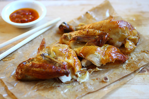 Hong Kong roasted chicken in pieces with a side of chili dipping sauce, ready to serve.