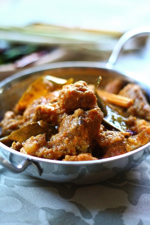 Easy and delicious homemade slow cooked Malaysian lamb rendang stew served in a skillet.