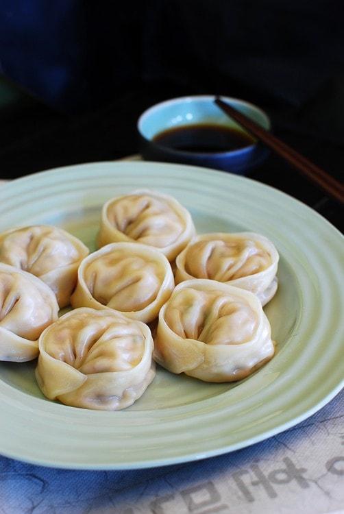Easy and quick Korean kimchi mandu served with a side of dumpling dipping sauce.