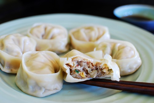 Easy korean mandu in half and picked by a pair of chopsticks.