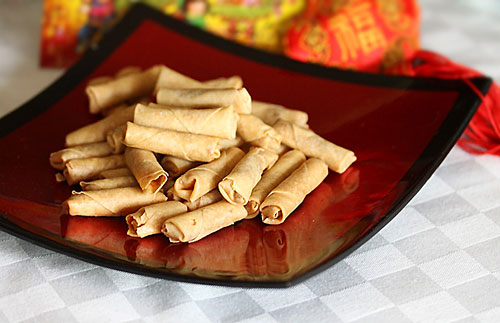 Chinese lunar new year crispy chicken floss spring rolls snacks served in a plate.