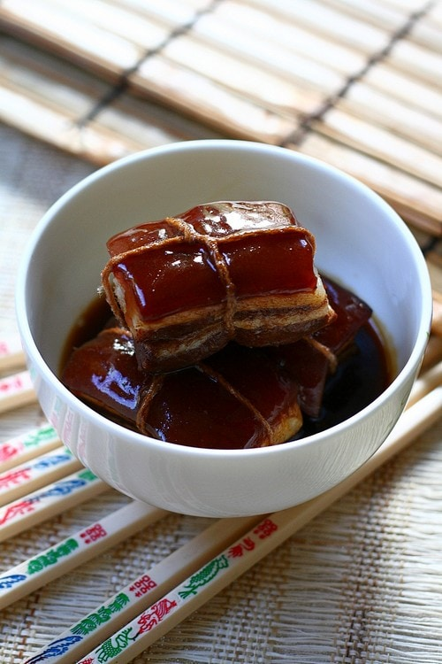 Easy and delicious Chinese slow cooked braised pork belly in thick brown sauce, ready to serve.