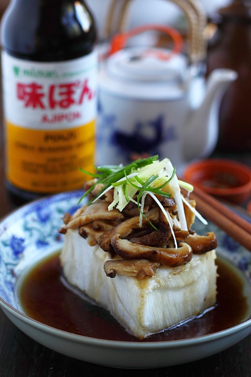 Easy and quick steamed fish in Chinese dark gravy topped with mushrooms and ginger, ready to serve.