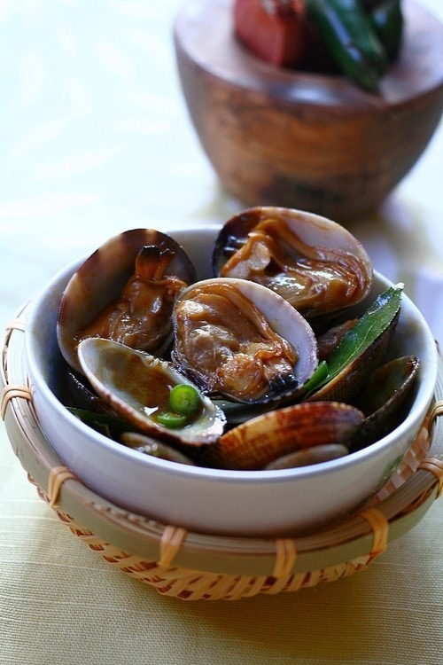Malaysian golden fragrant clams stir fry in thick brown sauce.