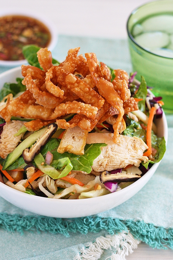 Easy Chinese Chicken Salad Recipe with dressing in the background to go with it.