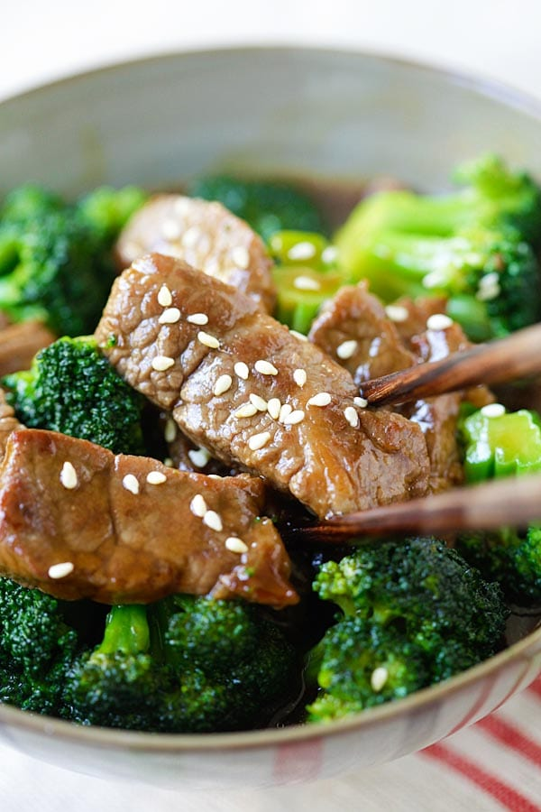 Tender beef and broccoli stir fry in a Chinese bowl, with a pair of chopsticks, ready to serve.