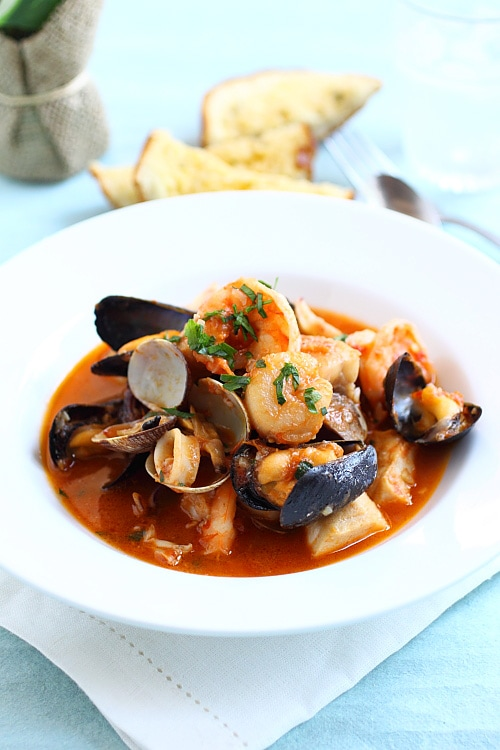 Easy and quick one-pot seafood Cioppino with shrimp, mussels and scallops in tomato-based cioppino sauce.