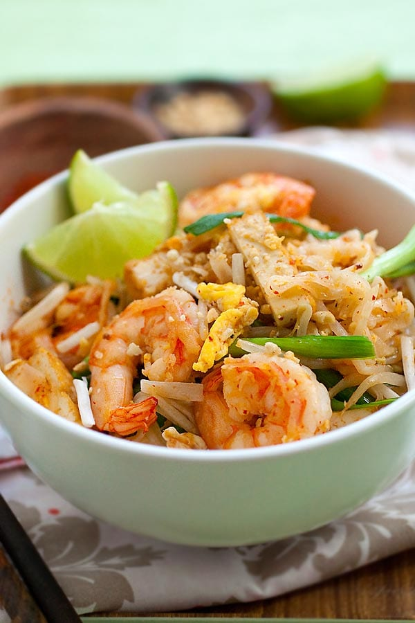 Pad Thai - an easy stir-fried noodles dish with rice stick noodles, shrimp, fried tofu, peanuts in Pad Thai sauce made of fish sauce, vinegar, sugar and chili powder. This is a traditional and authentic homemade recipe   rasamalaysia.com