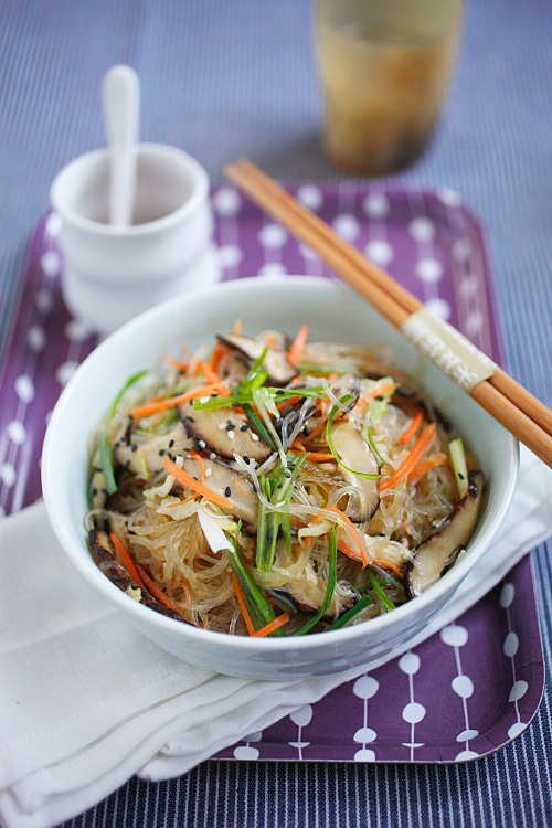 Chinese style vegetable fried noodles served in a bowl with a pair of chopsticks.